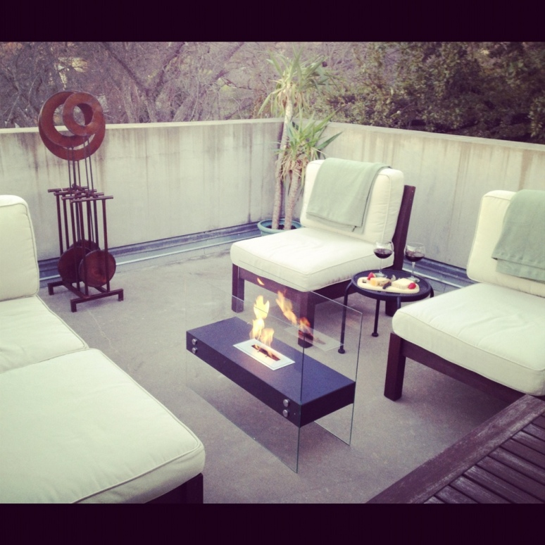 Outdoor sectional with modern glass fireplace